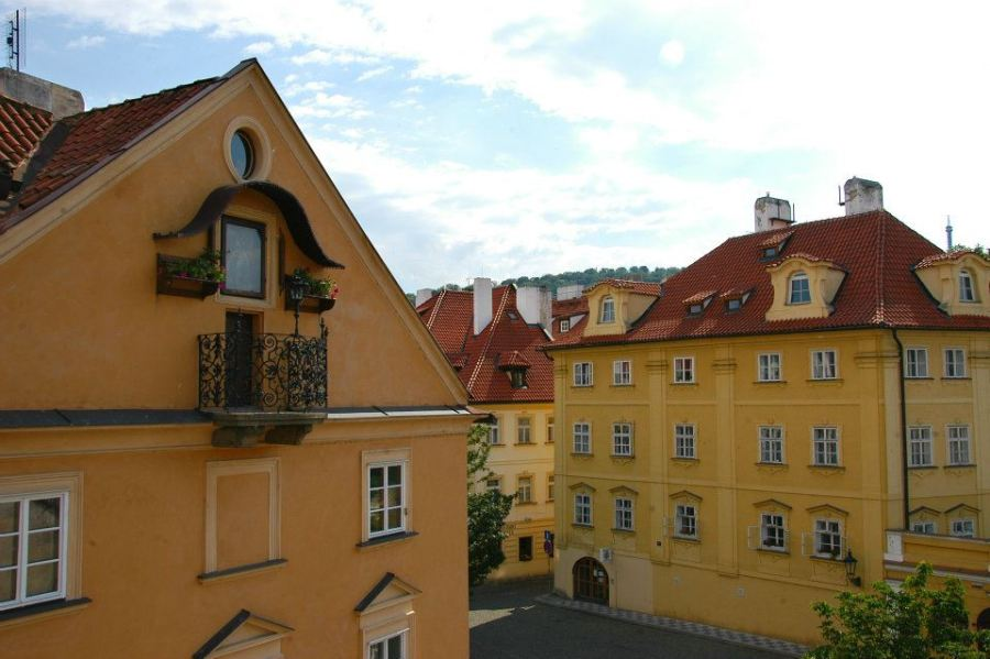 Colorful orange and yellow buildings in Prague, Czech Republic.