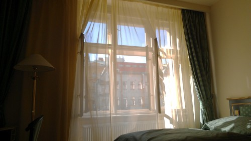 Sunlight on sheer curtains in a hotel room, Prague, Czech Republic.