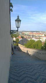 Man playing guitar on stairs near St. Wenceslas vineyard, Prague, Czech Republic.