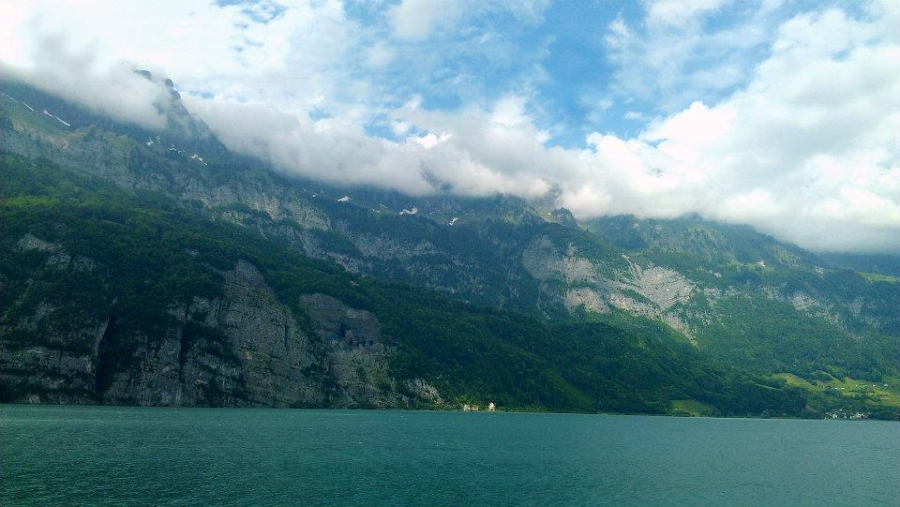 Water, sky, and mountains of Walensee Lake in Switzerland.