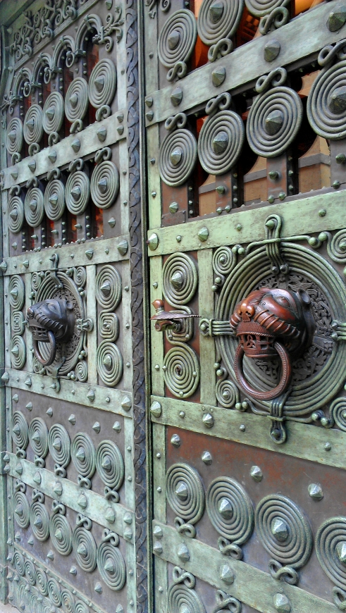 A detailed metal door of the Archdiocese of Freiburg, Freiburg, Germany.