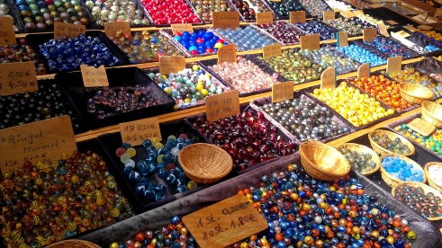 Colorful marbles for sale at The farmer's market in Münsterplatz, Freiburg, Germany.