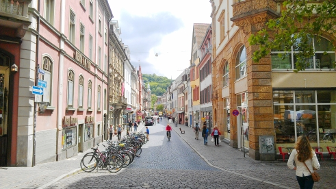 A street with colorful buildings and bicycles, Freiburg, Germany.