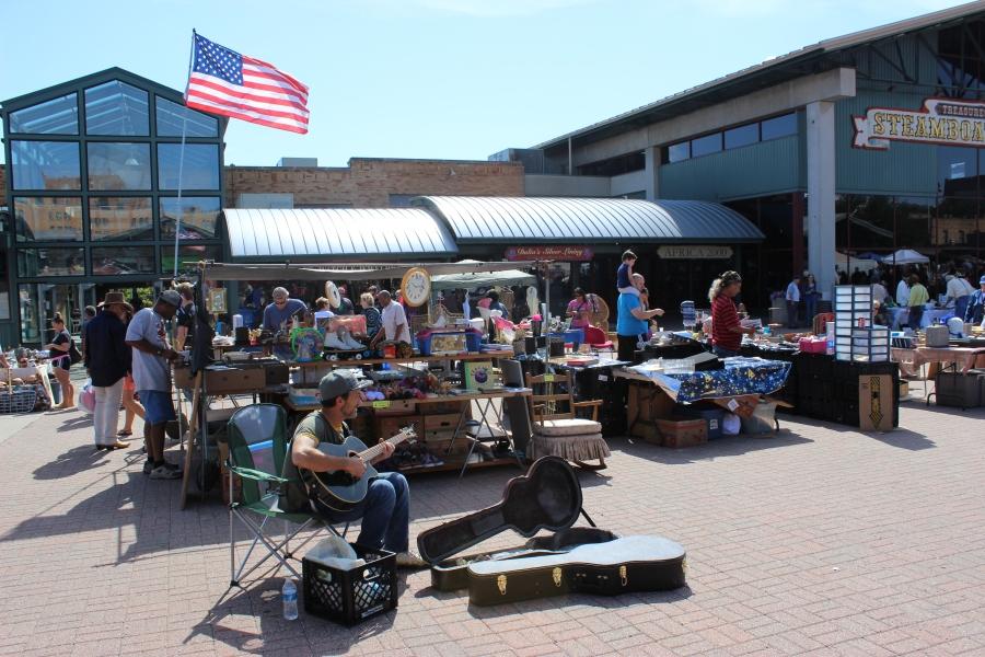 Man playing guitar at the Community Yard Sale at the City Market in Kansas City, Missouri.