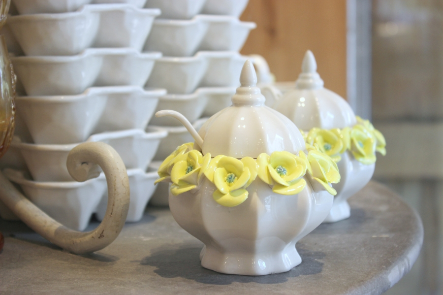 Anthropologie Crown Rose Sugar Bowls with yellow flowers at Country Club Plaza, Kansas City, MO.