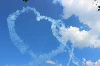 Airplanes and heart-shaped trails from the Air Show at Fair Saint Louis, Saint Louis.
