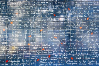 "A wall covered with ""I love you"" in every language."